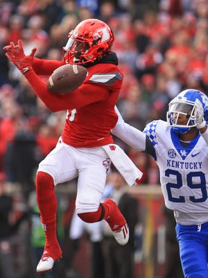 Louisville's James Quick can't make this catch in front of UK's Derrick Baity during the Wildcats' stunning 41-38 win over the No. 11-ranked Cards.