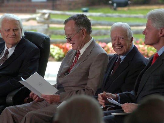 Billy Graham talks with former presidents Bush, Carter, and Clinton during the dedication ceremonies for the Billy Graham Library in Charlotte Thursday. (Steve Dixon - 5/31/07)