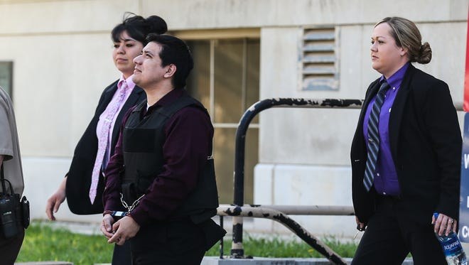 Isidro Miguel Delacruz is escorted out Thursday, March 29, 2018, from the Tom Green County courthouse. Delacruz was found guilty of capital murder in the death of Naiya Villegas.
