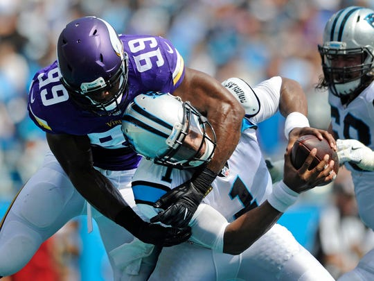 Carolina Panthers' Cam Newton (1) is sacked in the end zone for a safety by Minnesota Vikings' Danielle Hunter (99) in the first half of an NFL football game in Charlotte, N.C., Sunday, Sept. 25, 2016.