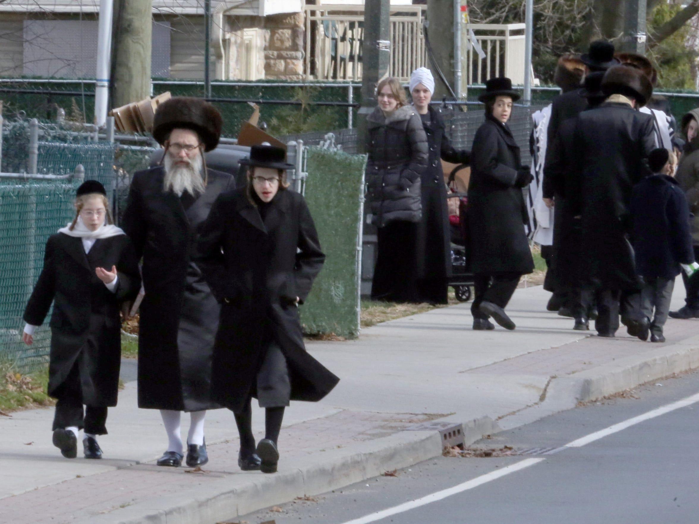 People walking home after Saturday afternoon Sabbath