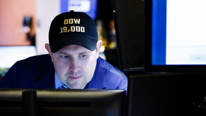 A trader wears a hat that reads 'DOW 19,000' on the floor of the New York Stock Exchange on  Nov. 22, 2016.