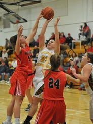 Bucyrus' Shaina Orewiler blocks the shot of Colonel