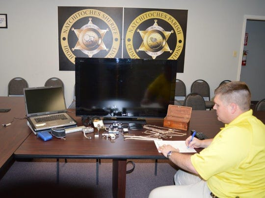 Detective Jonathan Byles inventories property recovered after two west Natchitoches Parish residential burglaries.