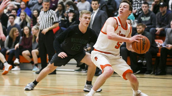 Sprague's Kaiden Flanigan looks for an open teammate in the final minute of a game against West Salem on Tuesday, Feb. 7, 2017, at Sprague High School. Sprague beat West Salem 71-65 to take first place in the Greater Valley Conference.