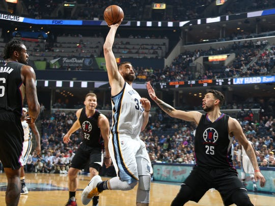 Memphis Grizzlies Marc Gasol, center, elevates for a shot against the Los Angeles Clippers, from left, DeAndre Jordan, Blake Griffin and Austin Rivers at FedExForum on March 8, 2017.