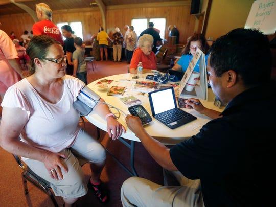 Rebecca Phillips gets her blood pressure taken by Community