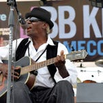 "Blues artist Jimmy ""Duck"" Holmes performs outside the B.B. King Museum and Delta Interpretive Center during the BB King Homecoming at the Museum in Indianola Sunday."