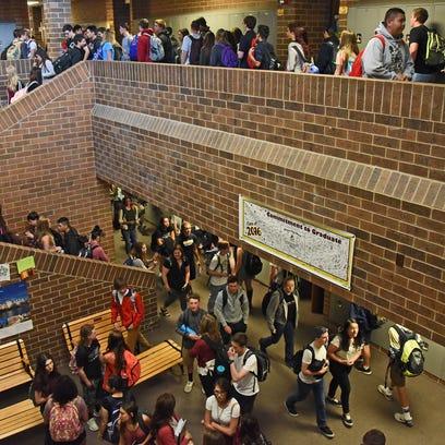 Students walk through the crowded hallways of Windsor