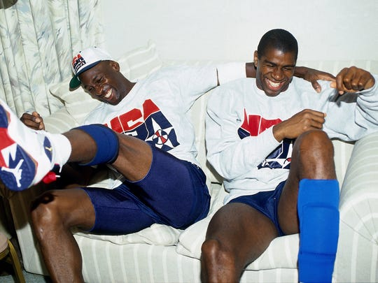 Michael Jordan and Magic Johnson share a laugh during