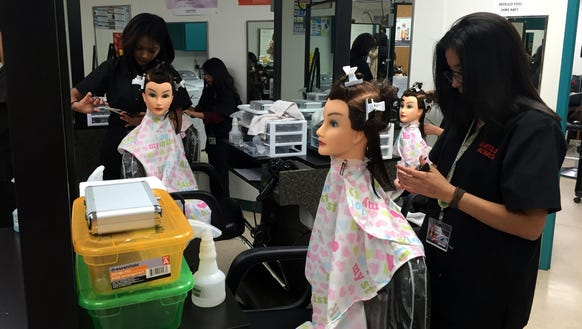 Cosmetology students practice haircuts at the Center