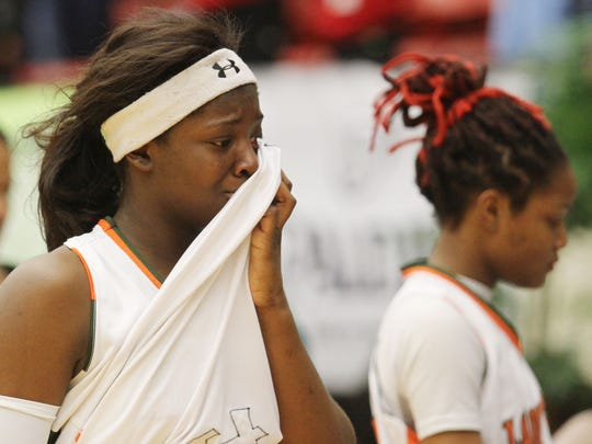 Dunbar's Ja' Miah Bland reacts after losing to Lake Highland Prep during the Class 4A state championship game at the Lakeland Center.