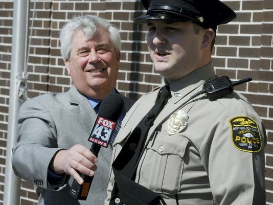 Tom Kearney, York County District Attorney, is all smiles as he listens to Northern Area Region Police officer Stephen Lebo talk about using naloxone to help revive a man who had overdosed on Thursday, April 2, 2015. Record/Sunday News