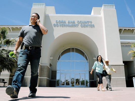 Visitors walk in and out of the Doña Ana County Government Center building on Friday. On average, county employees earn 37,254 per year.