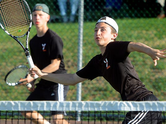 York Suburban's Elliot Diehl eyes a shot at the  net playing with partner Michael Peck in the background in the York-Adams League Class AA Doubles Championship at South Western High School on Wednesday. Diehl and Peck won the crown for a second straight year.
