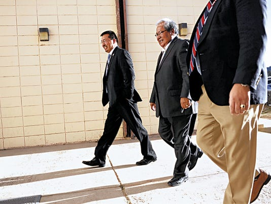 Navajo Nation Council Speaker Johnny Naize, center, walks into Window Rock District Court in Window Rock, Ariz., on Tuesday before his arraignment. Naize  pleaded not guilty to charges he misused discretionary funds.