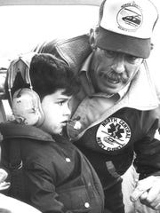 Mercy Flight pilot Jim Meyer explains helicopter controls to a kindergartener during a hospital tour a month before he died in a crash near Gibson Dam.