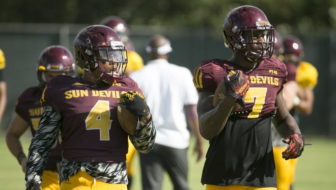 Arizona State running backs Demario Richard (4) and Kalen Ballage (7) warm up during the start of football practice at the practice facility in Tempe on Tuesday, August 23, 2016.