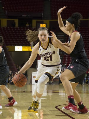 ASU's Sophie Brunner (21) drives against Stanford's Kaylee Johnson (5) in the first half at Wells Fargo Arena on Jan. 4, 2016 in Tempe, Ariz.
