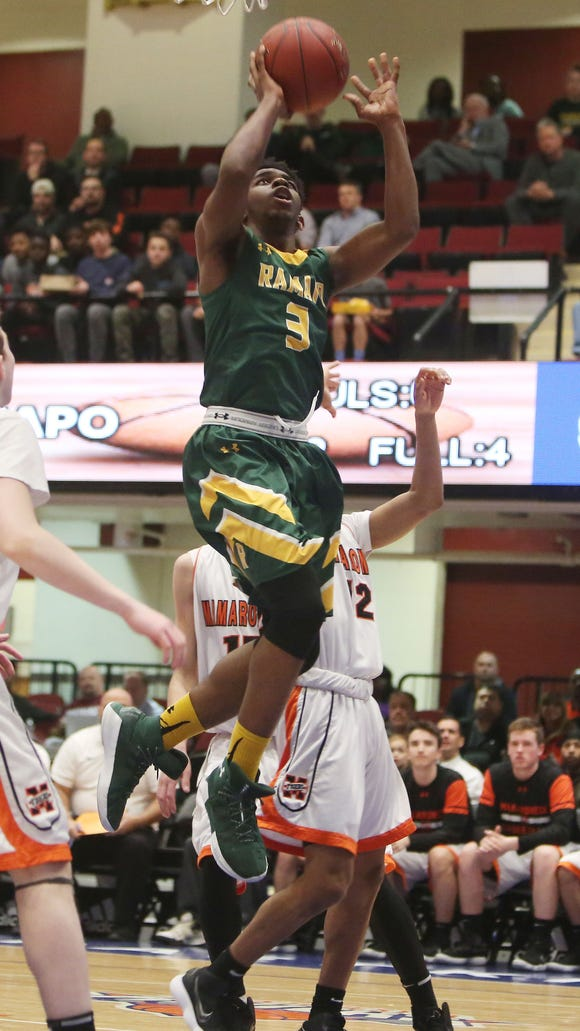 Ramapo's Anthony Simon (3) puts up a shot against Mamaroneck in the boys Section 1 semifinal at the Westchester County Center in White Plains Feb. 28, 2018. Final score Ramapo-47 to Mamaroneck-40.