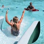 Tara Masten, 9, slides into the Fassnight Pool.