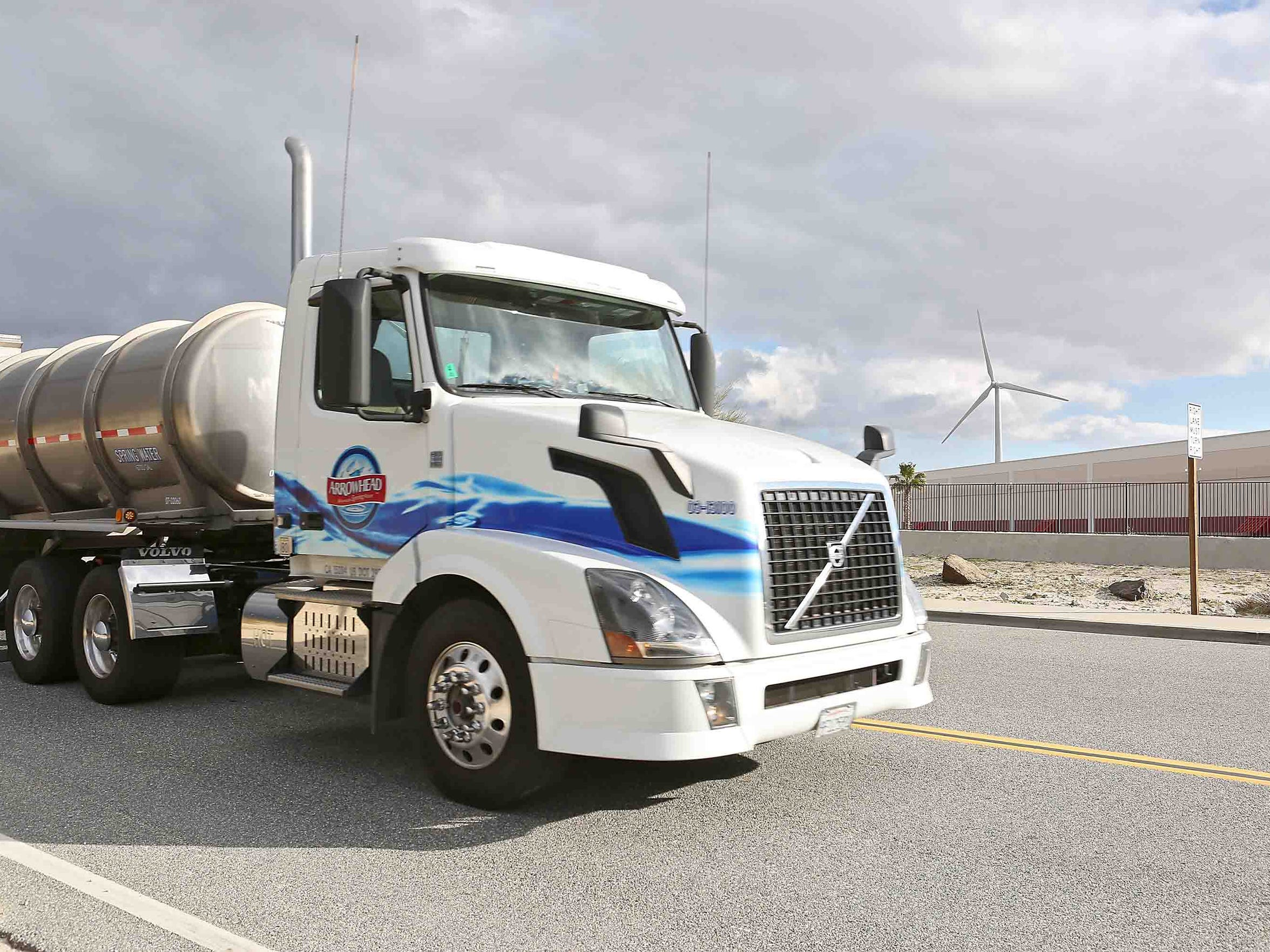 A truck carrying spring water enters the Arrowhead