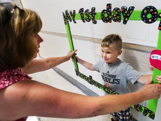 Matthew Eveler, having his picture taken on his first day of kindergarten at Hayshire Elementary School in August 2012. Some districts have discussed starting the school year earlier than normal, but there's also legislation proposed that would require districts to start after Labor Day.