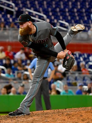 Diamondbacks reliever Archie Bradley (25) delivers a pitch during the  seventh inning of a game against the Miami Marlins at Marlins Park on June 25, 2018.