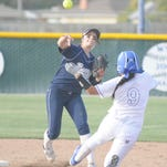 Redwood's Rebekah Cervantes turns a double play against Hanford West during a West Yosemite League softball game.