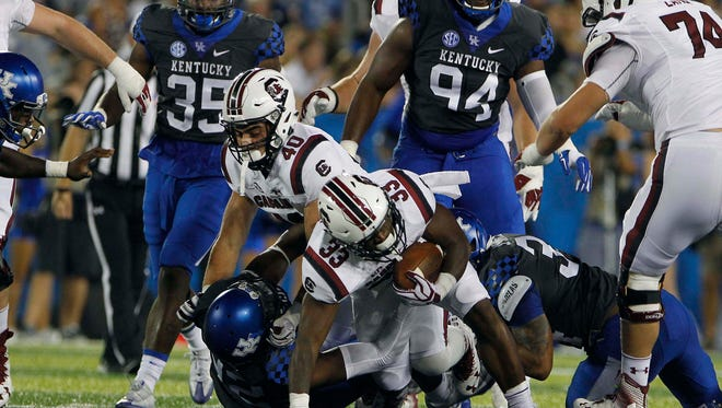 Sep 24, 2016; Lexington, KY, USA; South Carolina Gamecocks running back David Williams (33) dives forward during the game against the the Kentucky Wildcats in the first half at Commonwealth Stadium.