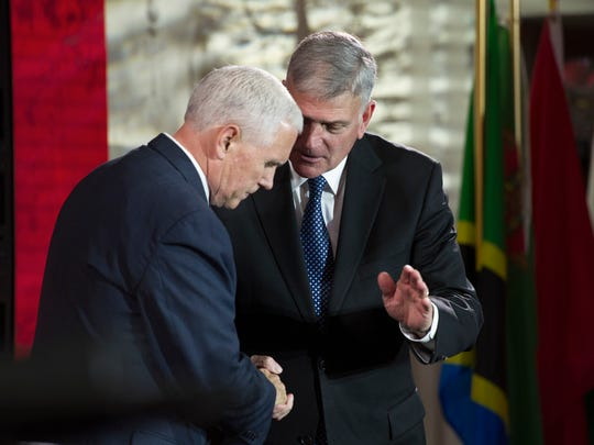 Vice President Pence speaks with Franklin Graham after addressing the World Summit in Defense of Persecuted Christians on May 11, 2017.