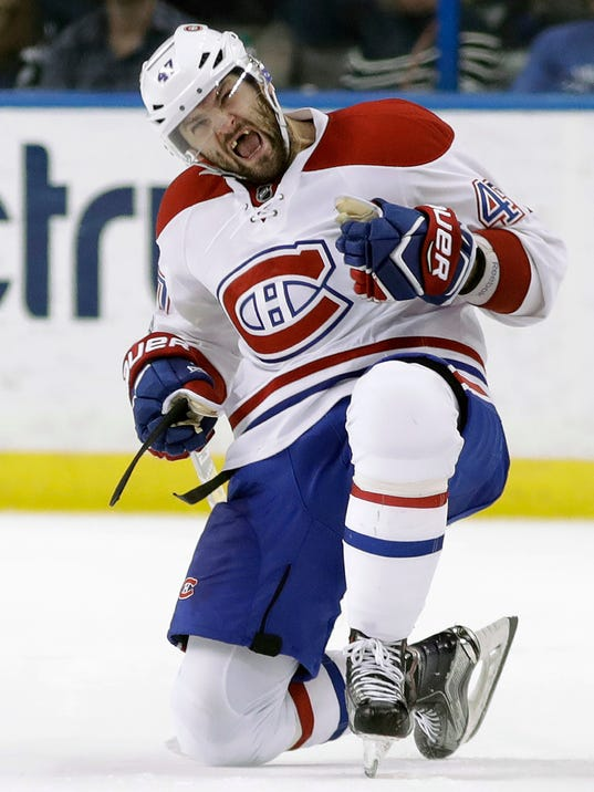 FILE - In this April 1, 2017, file photo, Montreal Canadiens right wing Alexander Radulov celebrates his overtime goal during the team's NHL hockey game against the Tampa Bay Lightning in Tampa, Fla. If Montreal lets Radulov test the market following a 54-point season, the 30-year-old Russian will almost certainly get a raise off a $5.75 million, one-year deal he signed to return to the NHL .(AP Photo/Chris O'Meara, File)