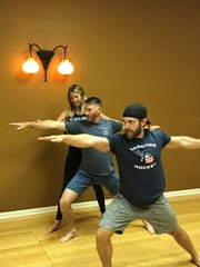 With instruction from Michigan Yoga Room's Sheri Rieli