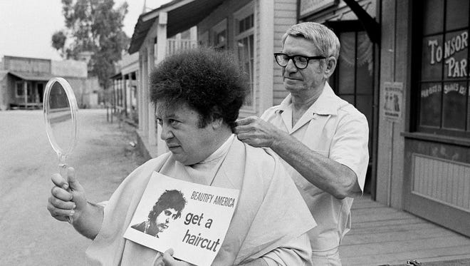 In this Aug. 15, 1968, file photo, comedian Marty Allen, member of the comedy team of Allen & Rossi, has his hair styled by barber Sol Goldstein in Hollywood, Calif.