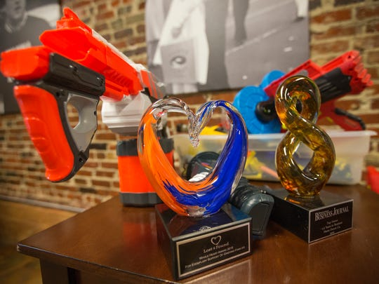 Nerf guns sit near a couple of awards at the Hurts Donut corporate office in downtown Springfield on Monday, November 28, 2016.