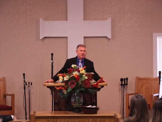 """""""Bringing Up Bates"""" star Gil Bates speaks at a service in their new congregation space."""