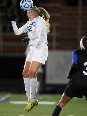 Scotch Plains-Fanwood vs. Montclair girls soccer in the NJSIAA Group IV semifinals held at Somervill High School in Somerville.   Scotch Plains-Fanwood's # 22 Christina Rodgers gets her head on the ball during 1st half action.    On Wednesday November 19,2014 Photo: Mark R. Sullivan/Staff Photographer