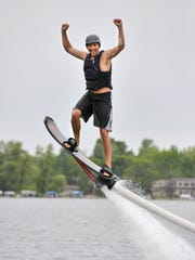 Flyboarder/hoverboarder Garrick Grace takes an Iron Man-like stance as he flies June 10 on a hoverboard during a demonstration for Just Add Water Flyboard on Sugar Lake near Maple Lake.