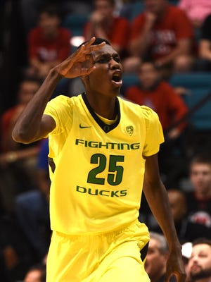 Oregon Ducks forward Chris Boucher (25) celebrates after making a three point shot during the first half in the championship game of the Pac-12 Conference tournament against the Utah Utes at MGM Grand Garden Arena.