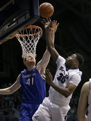 Butler Bulldogs forward Kelan Martin (30) puts up a shot over Creighton Bluejays center Geoffrey Groselle (41) in the second half of the Big East Conference basketball game Tuesday, Feb 16, 2016, evening at Hinkle Fieldhouse. The Butler Bulldogs defeated the Creighton Bluejays 88-75.