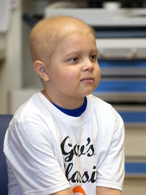 Brody Stephens, 7, in his room at Riley Hospital for Children, Wednesday, July 13, 2016. Bob and son Daniel Gavaghan, family friends of Brody, are using proceeds from their annual charity backyard basketball game, to send Brody on a trip of his choice.