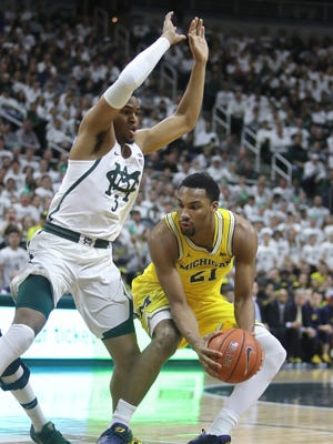 Michigan State guard Alvin Ellis III defends against Michigan guard Zak Irvin in the first half Sunday, Jan. 29, 2017 at the Breslin Center in East Lansing.