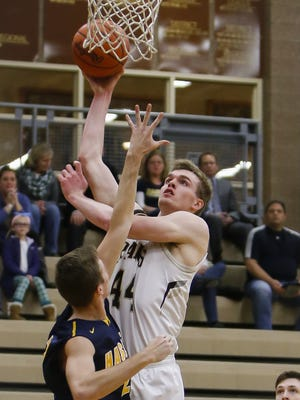 Holt's Jaron Faulds ranks among the leaders in the Lansing area in scoring and rebounding.
