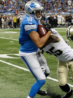 Detroit Lions Corey Fuller is knocked out of bounds at the 16 yard line by New Orleans Saints Rafael Bush after Fuller's first down pass reception that set up their winning touch down against the New Orleans Saints in Detroit on Sunday, October 19, 2014.