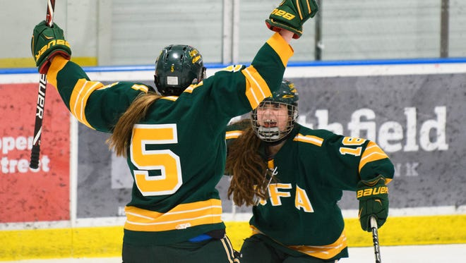 BFA's Linsey Larrow (5) and Peyton Dukas (16) celebrate the go ahead goal during the girls high school hockey game between BFA St. Albans and Mount Mansfield/Champlain Valley Union at the Essex Skating Facility on Saturday afternoon February 24, 2018 in Essex. (BRIAN JENKINS/for the FREE PRESS)
