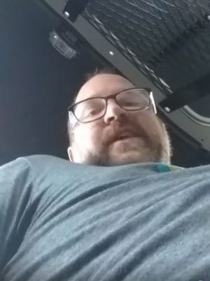 In this Feb. 20, 2018 screen grab from Facebook Live, activist Hunter Demster broadcasts himself while sitting in the back of a police car outside the Memphis Zoo.