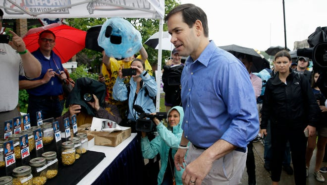 Sen. Marco Rubio, R-Fla., casts a vote for himself in a corn poll sponsored by a local television station during a visit to the Iowa State Fair on Aug. 18, 2015, in Des Moines.