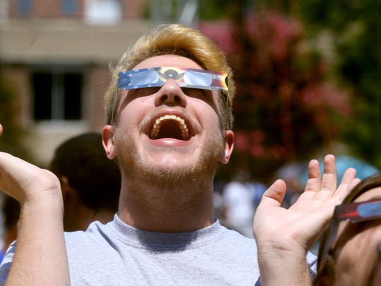 Jeremy Wright, 17 gets excited as he views the solar eclipse during an MTSU viewing party, on Monday, Aug. 21, 2017.