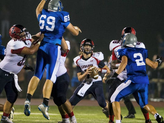 Lebanon quarterback Cody Kissinger looks to pass under heavy pressure during the 44th annual Cedar Bowl at Cedar Crest's Earl Boltz Stadium on Friday.