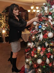 Virginia Hayward, of Simi Valley, puts finishing touches